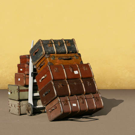 A Pile of Old Vintage Suitcases - Luggage