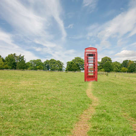 A British Telephone Booth Standing Alone in the Countryside photo