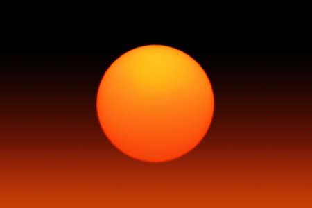 A Bright Orange Sun Background Stock Photo - 21956262