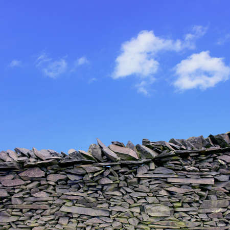 dry stone: A Dry Stone Wall with Blue Sky Stock Photo