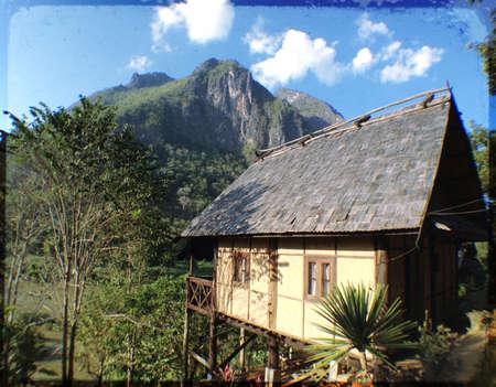 beside: Beautiful house beside Nong Khiaw River Northern Laos Stock Photo