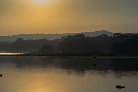 Sunrising over the lake with reflection mist on the water, Landscape sunrise concept