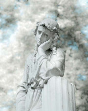 angel headstone: white statue in infrared look