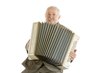 Old harmonica player on a white
