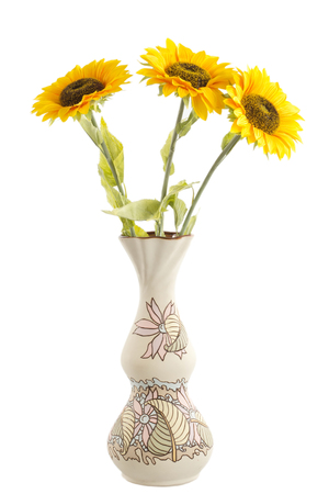 Beautiful sunflowers in the floor vase on a white background photo