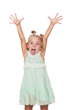 Little girl showing tongue, on a white background photo