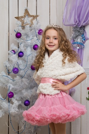 Little girl with christmas fir tree decorations