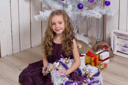 fir  tree: Little girl with christmas fir tree decorations