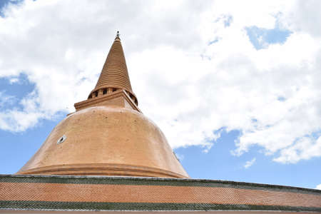 largest: Phra Pathommachedi with cloudy sky, largest pagoda of Thailand Stock Photo