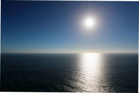 grieving: Natural background of sun on blue sky over sea
