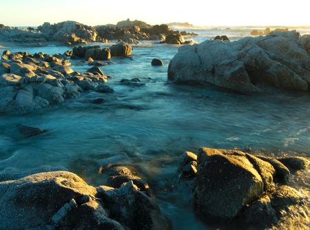 Romantic sunset at rocky coastline of Asilomar State Reserve, Pacific Grove near Monterey and Carmel, California, USA 写真素材