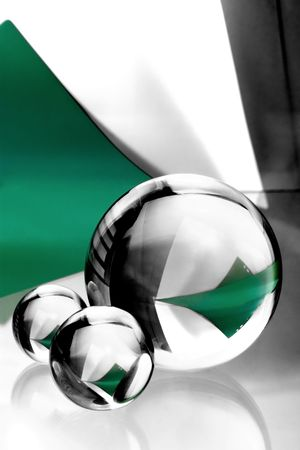 three glass balls on background of paper photo