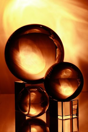 stil: three glass balls with yellow light and reflection