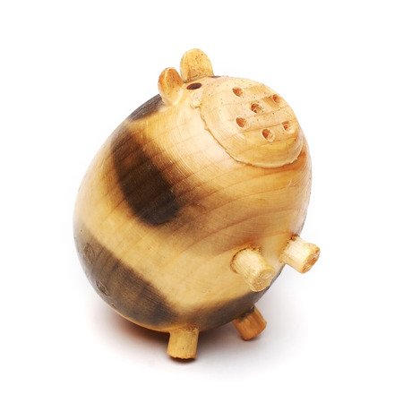 stood up: wood pig on isolated background