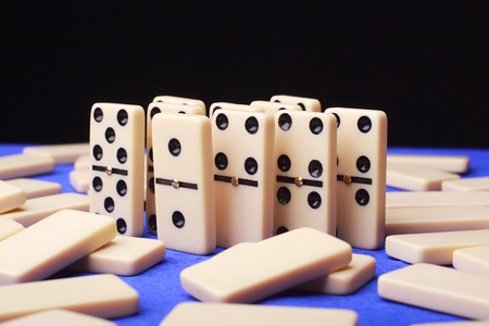 analogy: group of figures domino on blue background