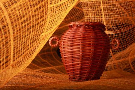 receptacle: ancient rods basken on orange background