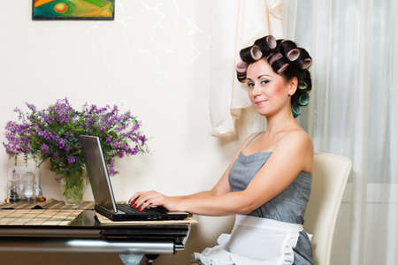 housewife in the dining room with notebook photo