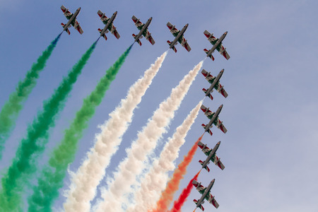 aerobatic: aerobatic team performing Alona low pass with italian flag colors smokes