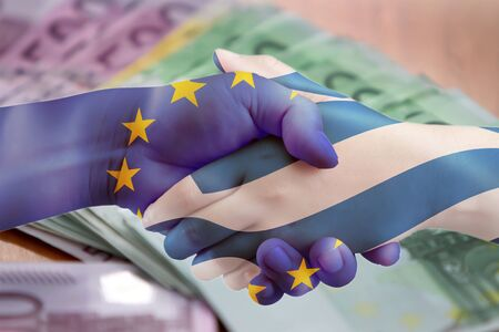 foreign nation: greece Europe agreement handshake with euro background