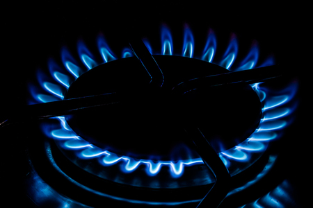 double oven: Cooking plate: cooktop - Gas stovetop burning in dark background