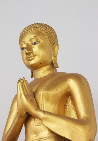 The thai golden statue buddha smiling and pay respect