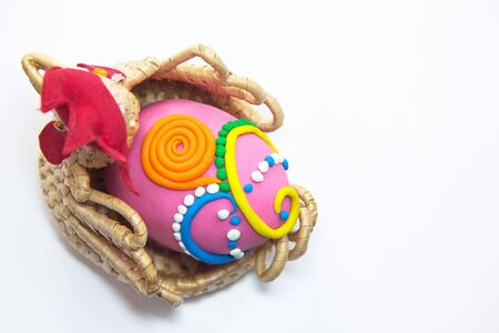 Easter egg fancy pink color white background Stock Photo