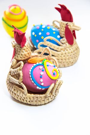 Easter eggs in basket on white background Stock Photo