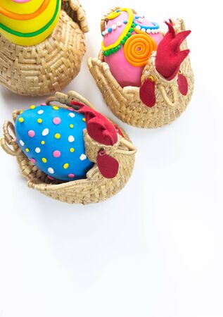 Three decorated easter eggs in basket isolated Stock Photo