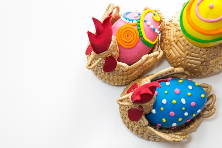 Three easter eggs in basket isolated