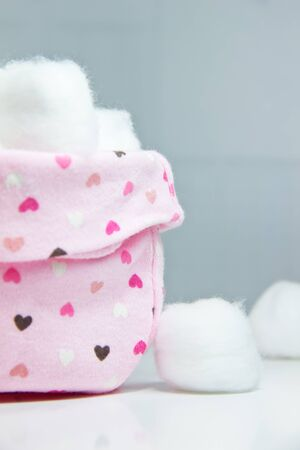 Cotton balls in pink bag side view Stock Photo - 12973100