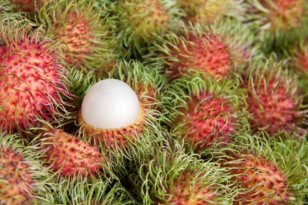 asian fruit rambutan on background