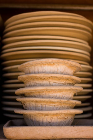 Disk pottery at the artist of Chiang Rai Thailand Stock Photo