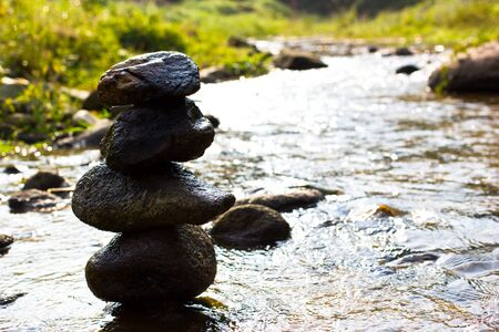 Zen in river forest, rock tower peace Stock Photo