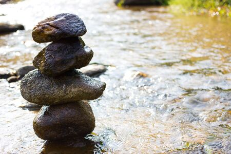 Zen, peace, rock tower in the river Stock Photo