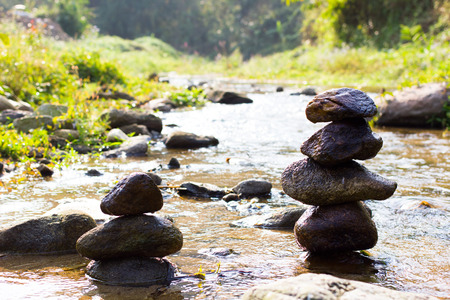 Rock tower balance in the river, zen Stock Photo