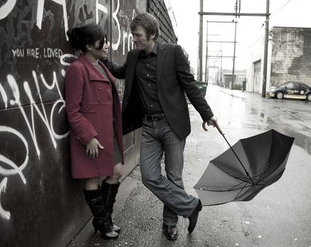 Couple talking in the rain Banco de Imagens