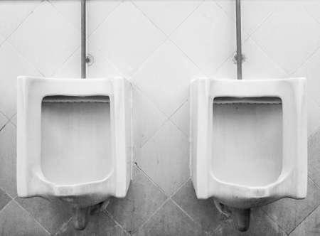 Vintage urinals in Outdoor men's bathroom.