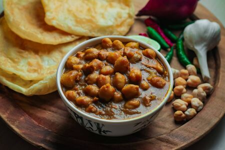 Chole Bhture or Chana masala is a Famous Indian dish originated initially from eastern Uttar Pradesh in the northern part of the Indian subcontinent.