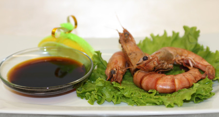 soy sauce: Delicious shrimp served with soy sauce greens.