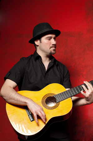 man playing guitar: Young man playing guitar with joy.