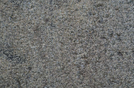 Gray rough granite. The texture of the stone.