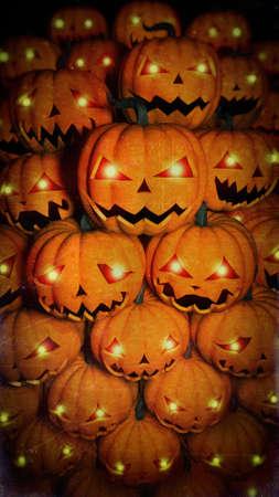 Halloween pumpkins with luminous eyes in the dark. Halloween horror illustration. Stockfoto