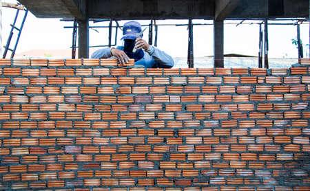 man doing Brick wall