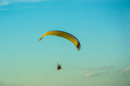 paramotor flying in the air photo
