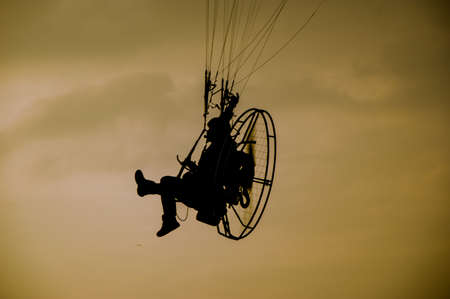 paramotor in sunset photo