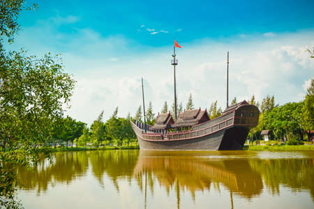 transportaion: old boat in the river