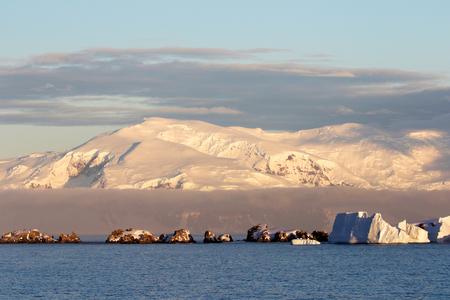 Antarctica on a Sunny day- Antarctic Peninsula - Sunset light and blue sky