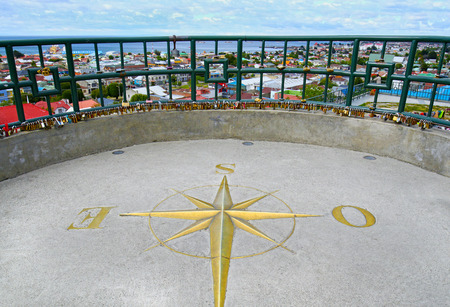 Punta Arenas View Point, Chile. Brass Decorative compass on the cement ground, pointing towards Antarctica, South Pole.
