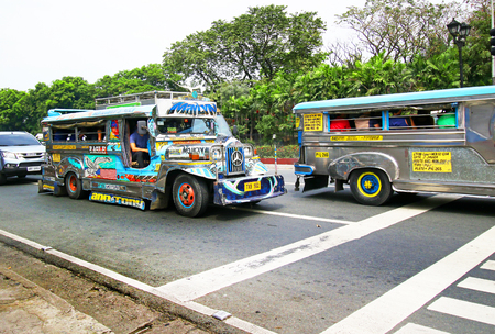 Manila, Philippines - Feb 3, 2017. Jeepneys running on a main street in Manila, Philippines. Jeepney is a cheap, popular public transport in Philippines