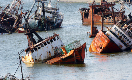 Abandoneold rusty ships in the Port of Montevideo, Uruguay. Old ship grave yard. Фото со стока